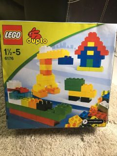 LEGOs, the box is open but never played with