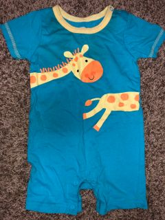 Adorable Giraffe Playsuit. Nice Condition. Size 6-9 Months. Camera picked up shadow. NO STAINS