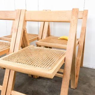 Four cane seat folding chairs