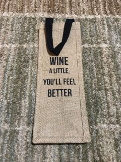 Wine carrying case. Has saying on both sides. NWT. Perfect for gift giving!