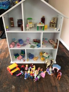 Doll house with furniture. Measures over 40 tall and 35 wide! So cute!! Awesome figures and kid friendly furniture. $50/all