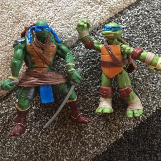 Two larger sized Nija turtles action figures