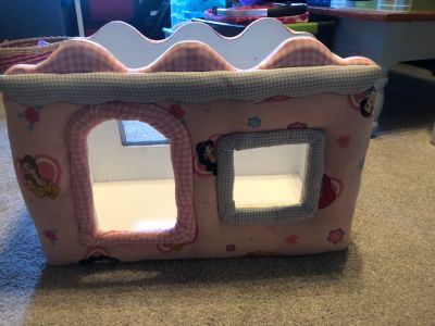 Large princess doll bed. We used it to store stuffed animals in my daughters room. Made of wood. Heavy and sturdy
