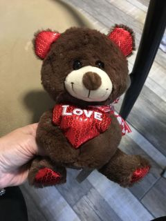 Super soft Love bear. Plastic tag thingy still attached.