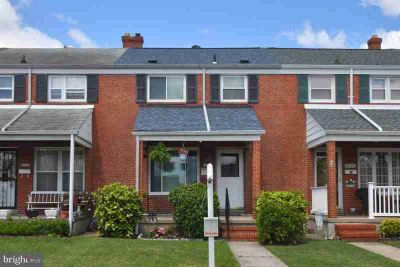 8004 Wallace Rd BALTIMORE Three BR, solid brick town home updated