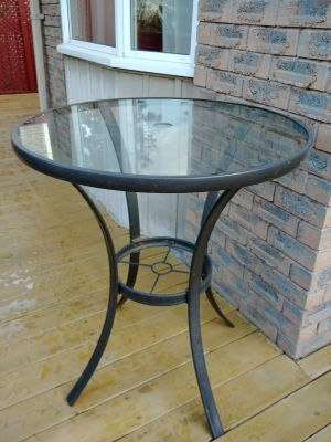 Wrought irob and glass outdoor table