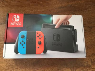 Nintendo Switch including 4 controllers and 2 games