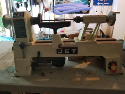 Jet wood lathe with extensions and tools.