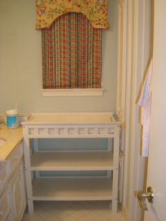 Changing table with pad and two pad covers