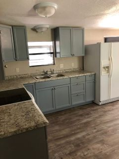 REMANUFACTURED MOBILE HOME AND BEAUTIFUL LAND