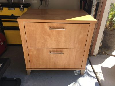 Lateral file cabinet, light wood.