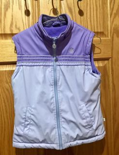 Weather Proof, Lilac/Lavender Vest with two front pockets, Size 6. Has a light pen mark on front by zipper area.