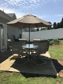 Patio Set! High quality! Price includes table, 6 chairs, umbrella and stand. Note the chair seat in last picture posted