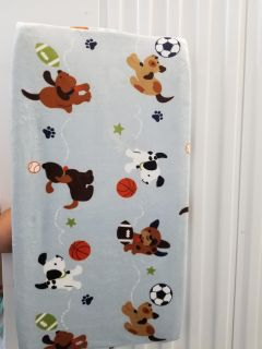 Changing pad with soft puppy cover
