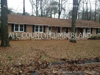 Lovely ranch style home, with open floor plan, hardwood, and sunroom with multiple ceiling fans.