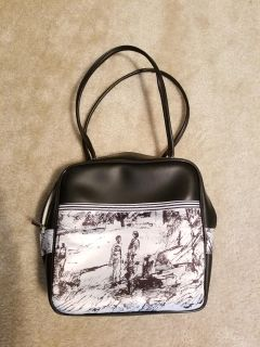 Black bowling style bag with silk print