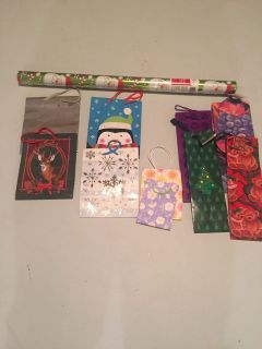 Gift Bags and New Christmas Santa wrapping paper.
