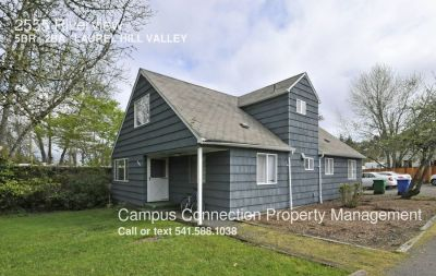 5+ Bed/2 Bath East Campus home with fenced yard and tons of parking - available July!