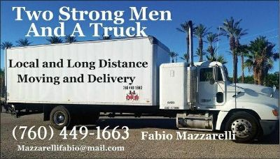 Two Strong Men And A Truck
