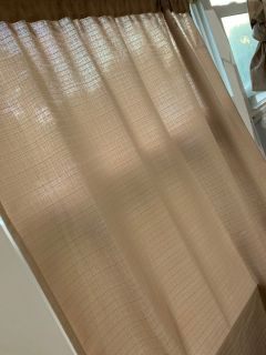 4 tan curtains