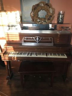 Antique piano and bench
