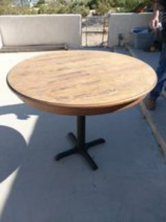 solid wood table with cast iron base