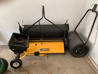 Lawn sweeper roller and spreader