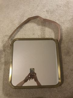 Gold mirror with leather strap