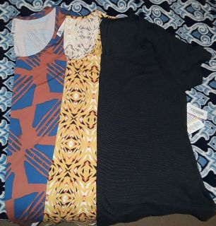 $35 Firm for all brandnew lot of 3 size 3xl Lularoe Classic T Tops one is heathered black-selling as lot only