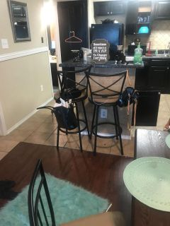Dinette table with four chairs and two matching bar stools had them for four months got emergency must sell asap
