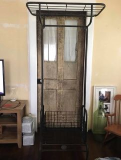 Metal clothing rack with removable basket