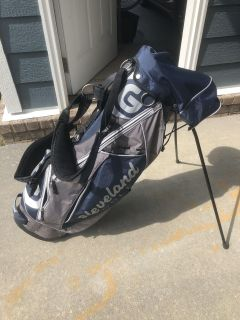 Cleveland standing golf bag with cover.