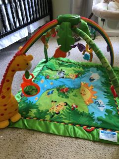 Fisher price rainforest play mat wth lights and sound. Multiple spots to hang toys. Universally compatible with all hook on hanging toys