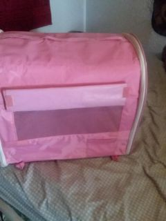 Pink pet carrier for small dog or cat