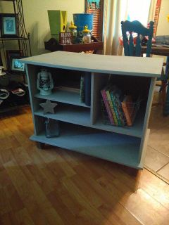 Tv stand or book shelf painted light grey with chalk paint