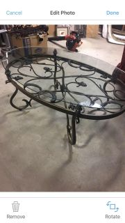 Glass top with iron base coffee table