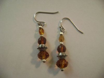 243 Pairs of Handmade Beaded Earrings. Brand new and packaged.