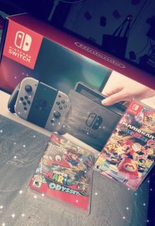Gray Nintendo Switch & Two Games