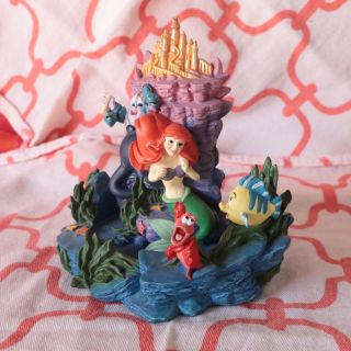 Little Mermaid statue with all characters