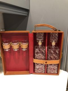 Vintage glass decanters with 3 shot glasses in a leather case