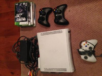 Xbox 360 w/ extra storage, controllers & 5 games