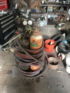 Acetylene Torch with hoses on wheels