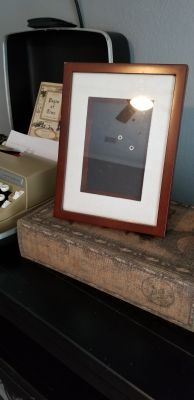 Picture frame light brown in color and black velvet on the back with stand or can be hanged 5x7, additional pictures