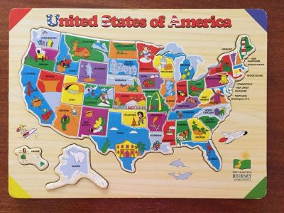 USA puzzle / state capitals below each piece / had to glue Alaska otherwise EUC