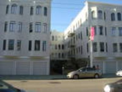 Large & Charming Top Floor Studio Apartment. w/ Hwd., Lndry. & Pkg. Avail.