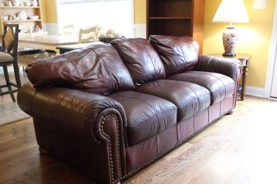 Burgundy Couch, Oversized Chair, and Matching Leather Ottoman
