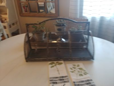 Cute metal basket - cabinet. Can sit on Surface or be wall mounted