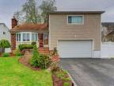 Real Estate For Sale - Four BR, Two BA Split