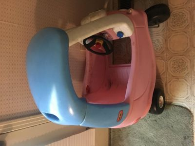 Pink and blue Cozy coupe car