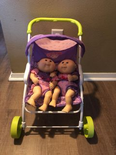 Twin cabbage patch dolls and stroller